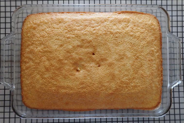 baked hot milk cake cooling in pan
