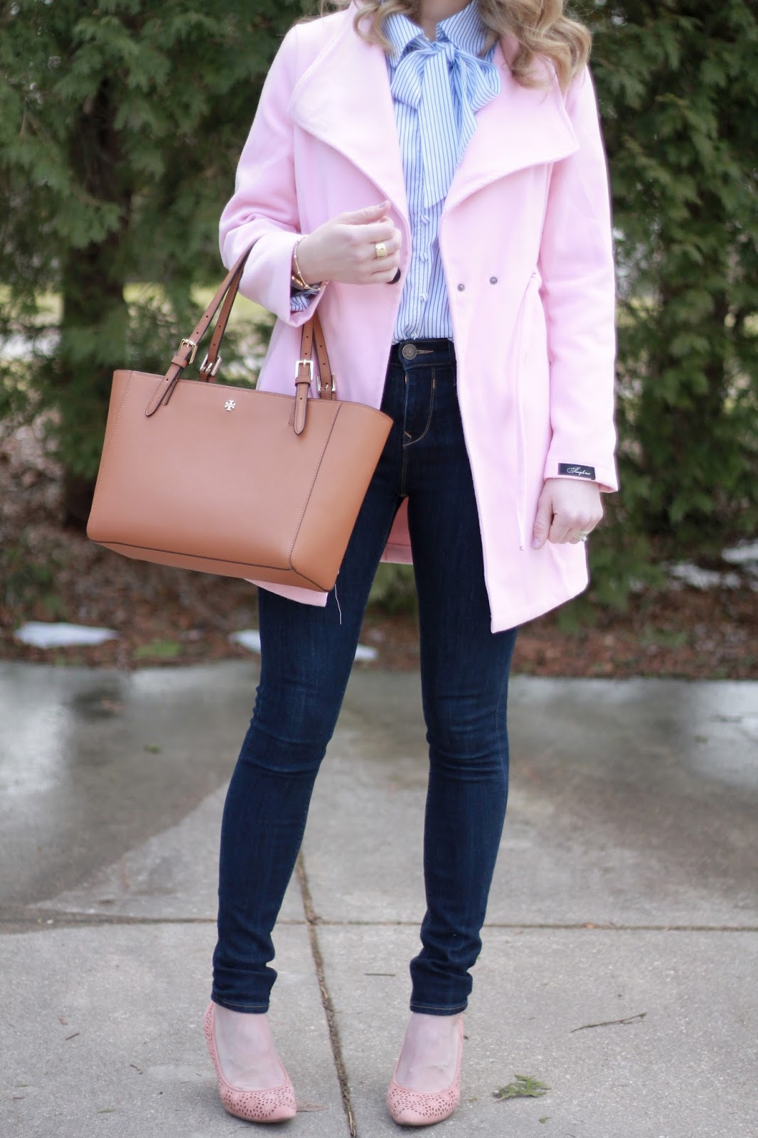striped bow tie blouse, light pink coat, Express dark skinny jeans, Tory Burch tote, pink heels