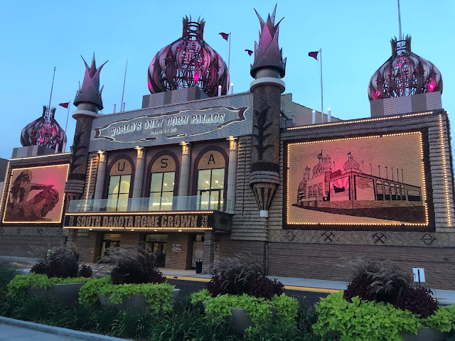 Spectacular Corn Palace lit up at night highlighting the structure's murals.