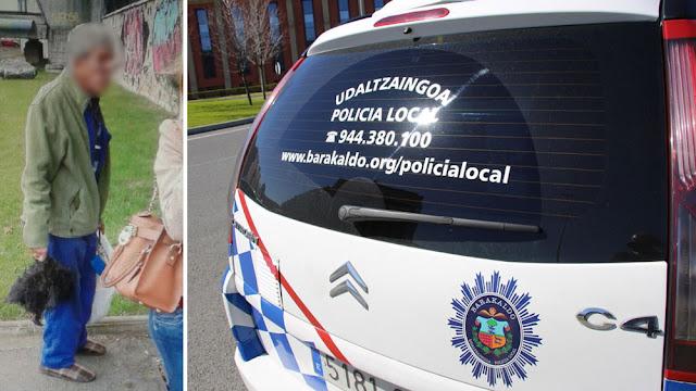 El individuo con la cabeza de perro en la mano y un vehículo policial