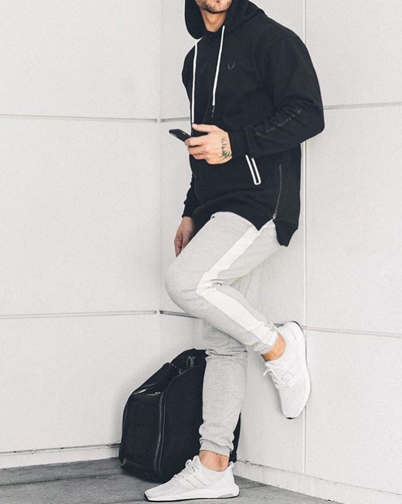 Man wearing Hoodie and joggers.
