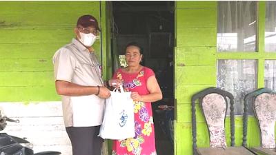 Dirut Perumda AM Padang Berbagi kepada Masyarakat  Sekitar Intake Ulu Gadut
