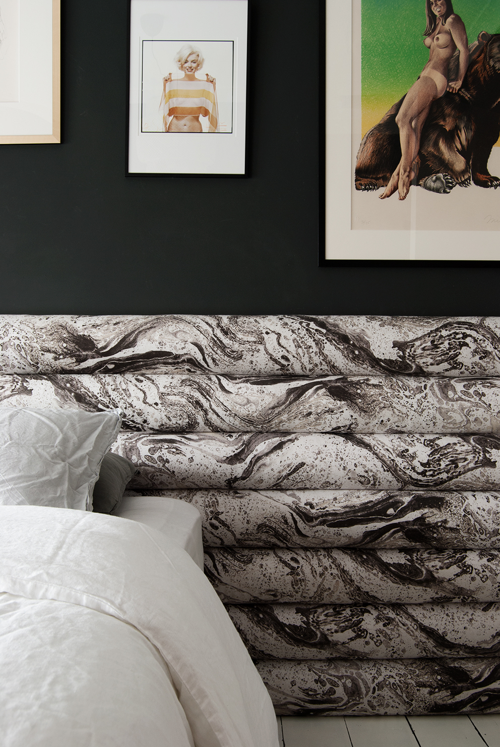 French For Pineapple Blog - Wall To Wall Channel Tufted Headboard.  Marbled fabric . Black Gallery Wall behind bed.
