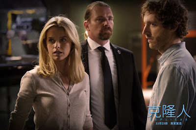 Movie still for the 2019 science fiction drama film Replicas where Alice Eve and Thomas Middleditch are escorted out of Keanu Reeves's laboratory