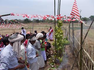 People worshiping during Karam Puja