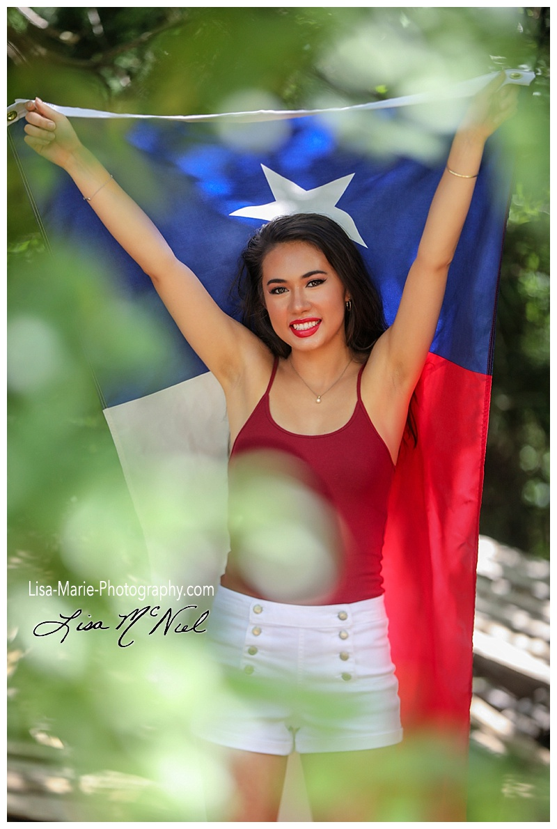 Asian teen with Texas flag