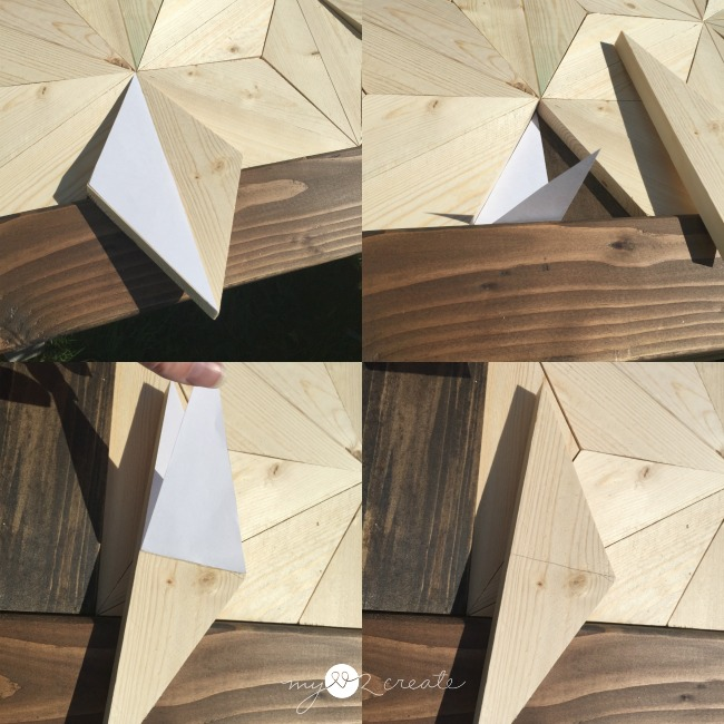 using a paper pattern to fit and cut wood pieces into geometric pattern into headboard