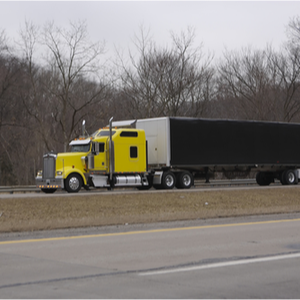 Trucker in yellow truck using TSNA for HVUT 2290 tax filing