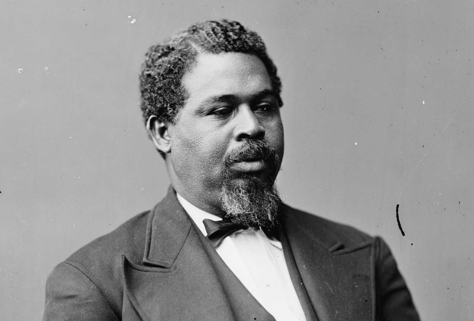 Robert Smalls was born a slave in South Carolina. During the Civil War, Smalls steered the CSS Planter, an armed Confederate military transport. On May 12, 1862, the Planter's three white officers decided to spend the night ashore. About 3 am, Smalls and seven of the eight enslaved crewmen decided to make a run for the Union vessels that formed the blockade, as they had earlier planned. Smalls dressed in the captain's uniform and had a straw hat similar to that of the white captain. The Planter stopped at a nearby wharf to pick up Smalls' family and the relatives of other crewmen, then they sailed toward Union lines, with a white sheet as a flag. After the war, he went on to serve in the United States House of Representatives, representing South Carolina.