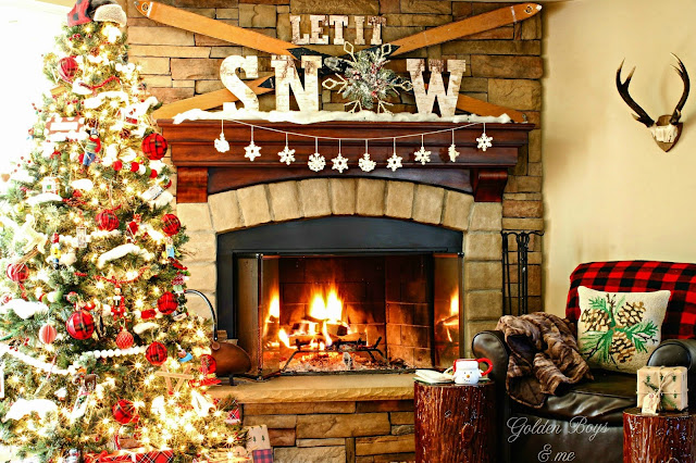 Rustic and cozy Christmas mantel with vintage skis and ski lodge style let it snow lettering - www.goldenbobysandme.com