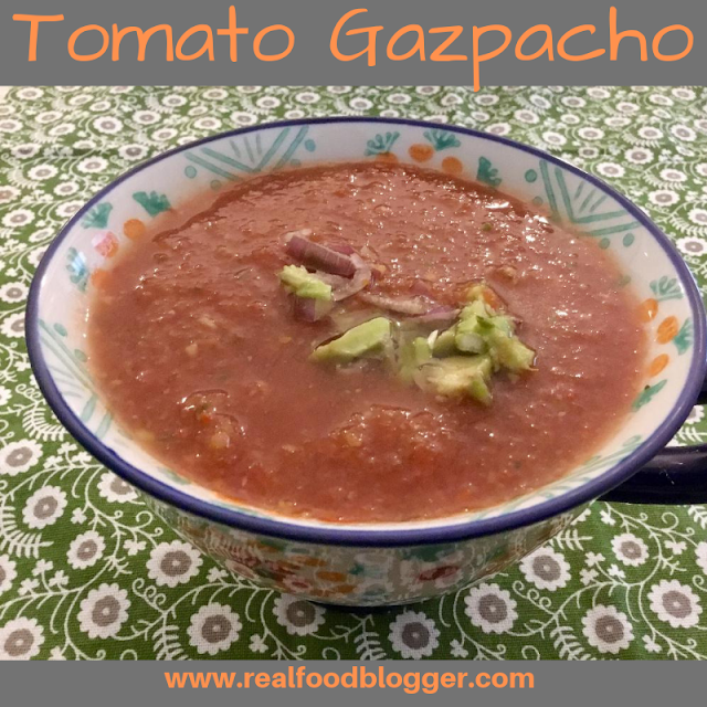 gazpacho topped with avocado and shallots