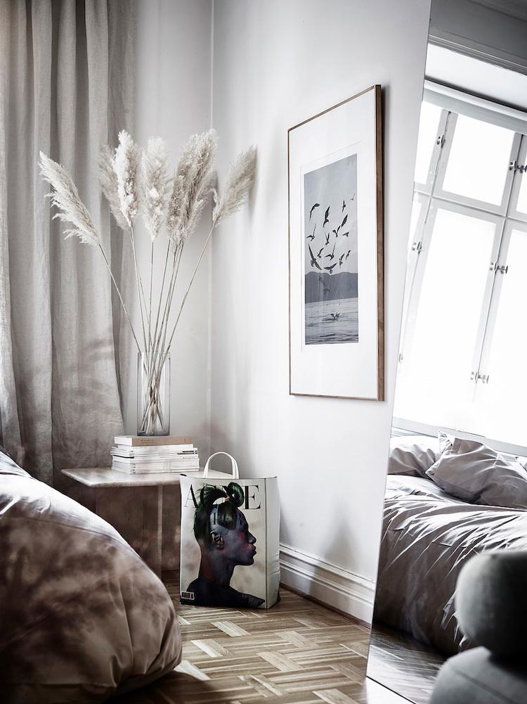 Scandinavian bedroom with leaning floor mirror via Entrance
