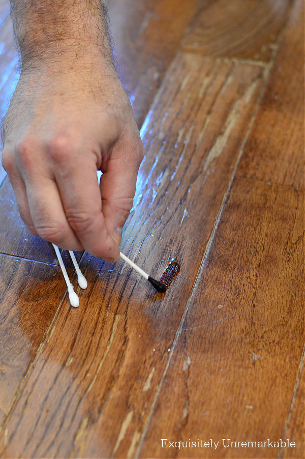 Using Wood Stain To Fix Wood Floor with a q-tip application