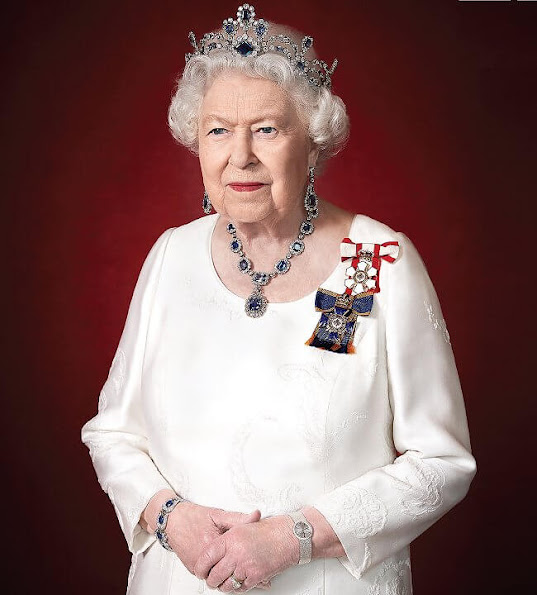 Queen Elizabeth is wearing Sovereign of the Order of Canada and the Order of Military Merit and Modern Sapphire Tiara and George VI Sapphire parure