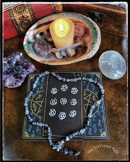 Nine of Pentagrams card from the Supernatural Join the Hunt tarot deck.