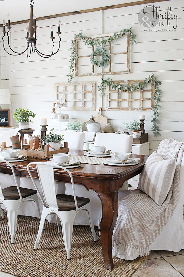 Summer dining room decor and decorating ideas. Farmhouse dining room decor. Farmhouse tablescape decor. DIY place setting ideas. Dining room buffet ideas. Farmhouse chandelier. Wood and metal chandelier. Dining room wall decor. Wood and white dining room decor.