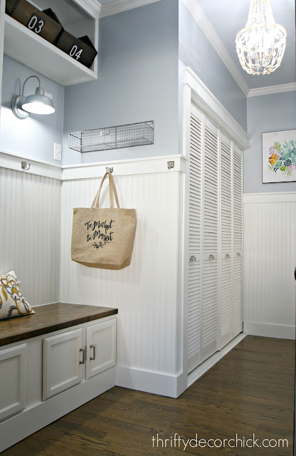Beadboard mud room with blue walls