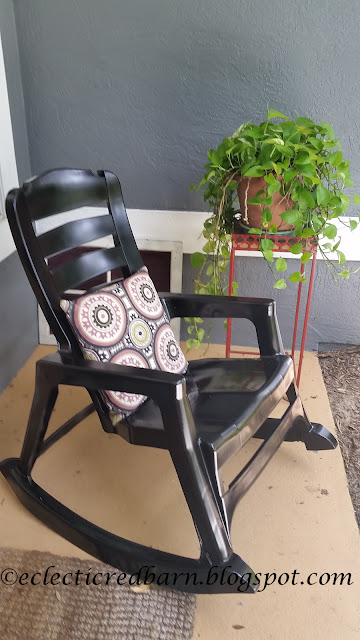 Updated plastic rocking chair with pillow