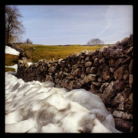 Snow on stone walls