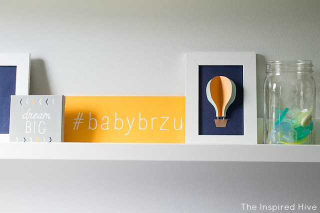 Navy, orange, and aqua hot air balloon nursery
