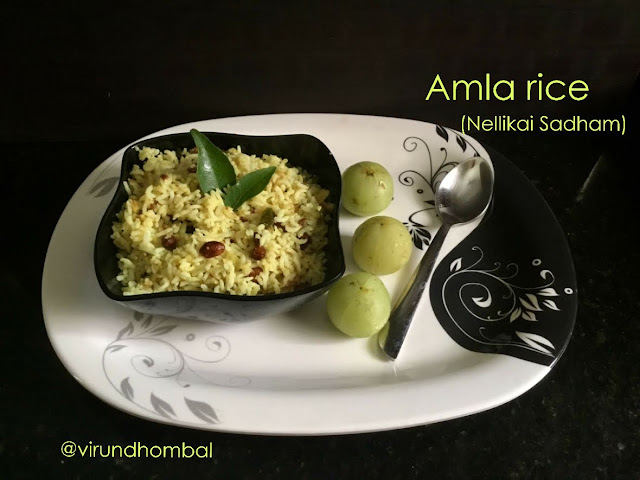 Amla (Gooseberry) Rice | Nellikai Sadham - Nellikai Sadham - a healthy rice for your lunch box with simple cooking methods. Once again thanks to my Karthi Uncle who taught me the Aloo Gobi recipe prepared this healthy rice. The way we prepare for lemon rice and mango rice applies to this Amla(Nellikai) rice also. In addition, we want to grind the amlas in a mixer jar without any water and then we have to saute it with our classic tempering ingredients. Ponni raw rice is much preferred when preparing these type of rice varieties, but if you are looking for a healthier choice you may replace it with cooked millets.  Now a days we can see there is an increase in consumption of amlas in our regular diet because of its medicinal values. We can include it in a variety of ways in our diet as juice, powder and pickles. We  steam  the amlas in an Idli pot and add it to any kuzhambu or simply as a side dish for curd rice.  This 20 minute easy rice dish can be prepared in advance and you can enjoy it warm or  at room temperature. Green chillies and red chillies give the rice a more flavour for these types of rice dishes. So please do not omit or reduce it. In fact you can also include finely chopped ginger too to add more flavours. And do not forget our most important hidden star ingredient asafoetdia powder for this rice. Pair your Amla rice with any poriyal, kootu or any sundal and prepare a healthy lunch for your family.