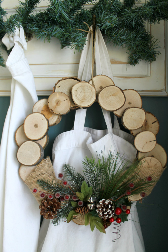 Rustic wood slice holiday wreath the wicker house