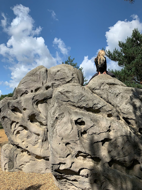 7 year old on top of an artificial climbing boulder at Fairlop Waters Country Park