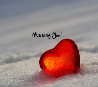 missing you with crystal red heart in white sand photo