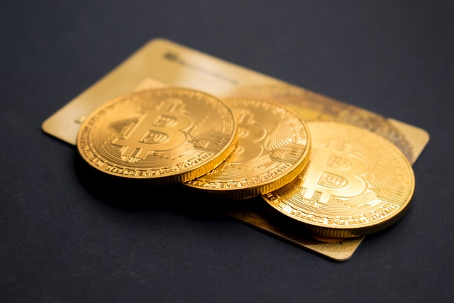 Golden coins on the table - say no to greed for riches