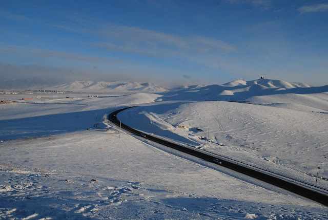 An asphalt road in Mongolia in winter