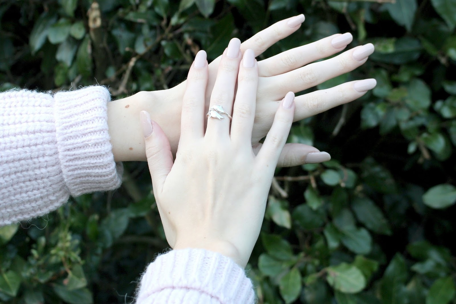 Pale hands with nude nails