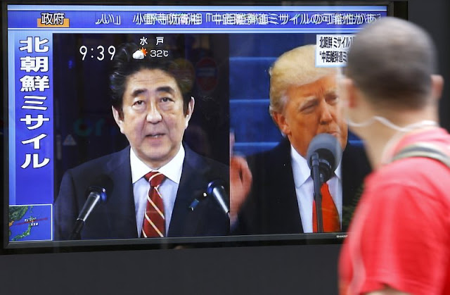 Japan leader gets on phone with Trump on missile