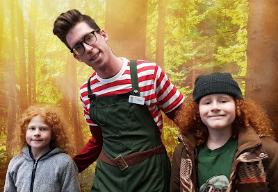 Chill Factore grotto helper elf who is very tall and looks like arthur christmas with my two boys