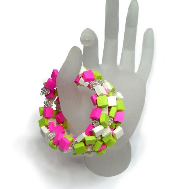 Lime green, hot pink and white resin cubes strung with silver wire beads on a multi-layered wrap bracelet