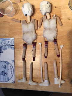 Two wooden puppet bodies, with sculpted caly heads made by Corina Duyn
