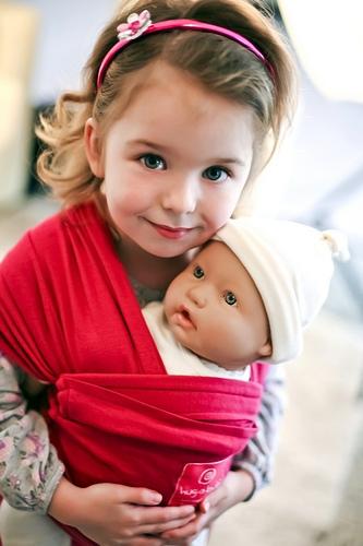 Criança usando sling