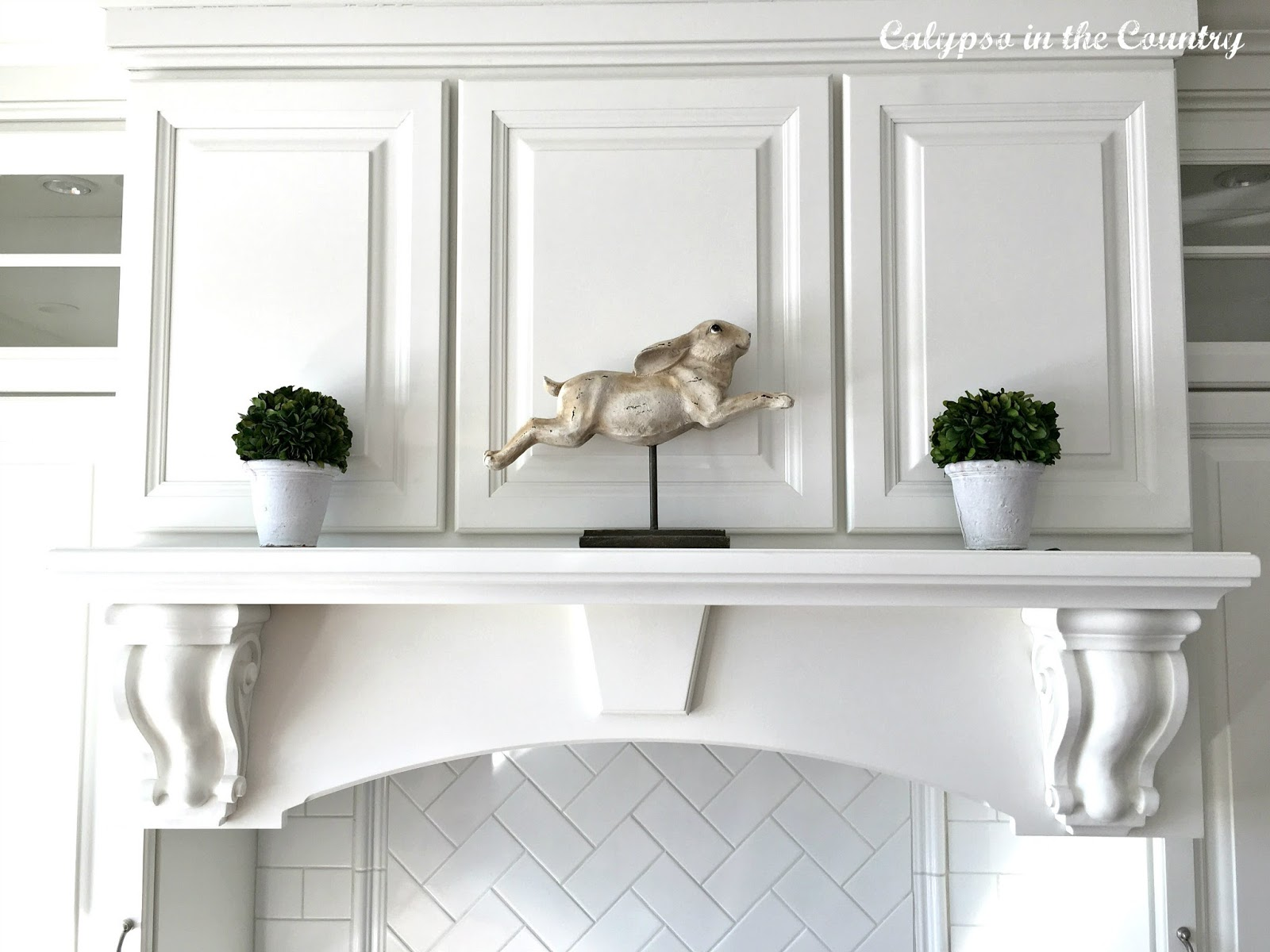 Bunny decor on stove mantel