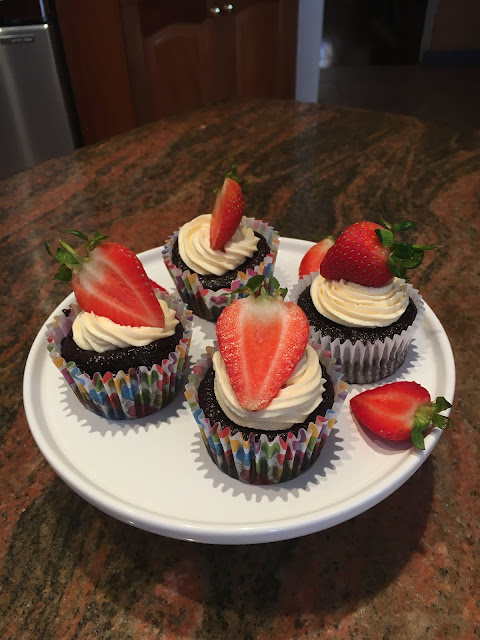 Chocolate Cupcakes with Cream Cheese Frosting topped with Strawberries on a White Platter