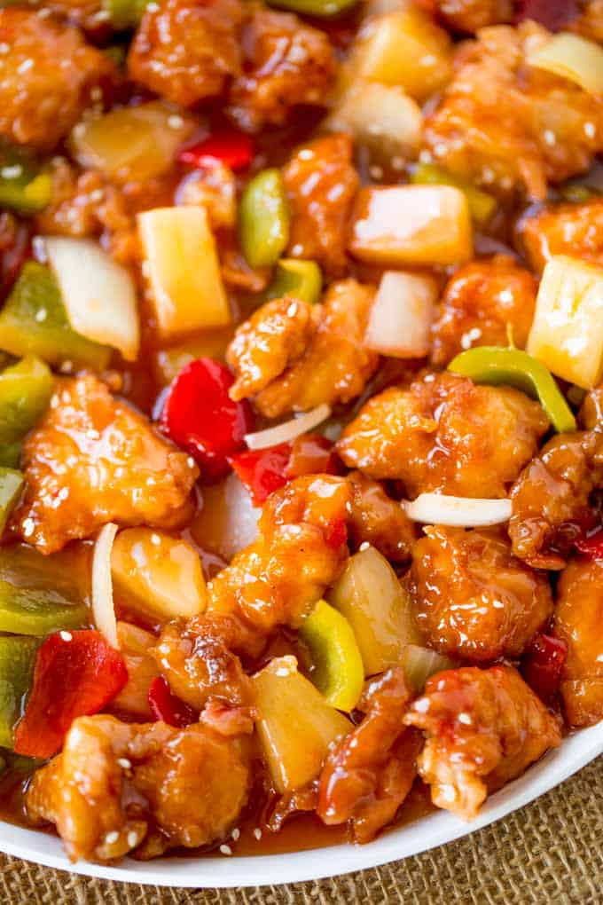 Sweet and Sour Chicken with crispy chicken, pineapple and bell peppers just like your favorite takeout place without the food coloring.