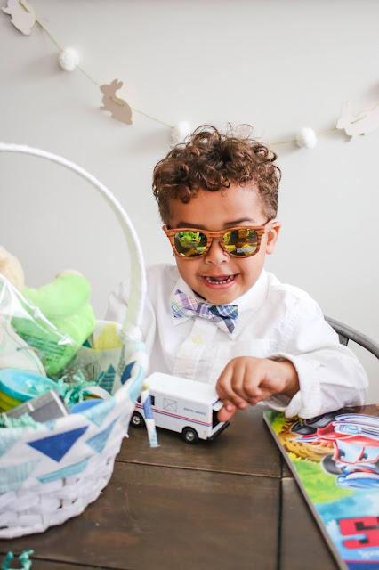 Little boy playing with toy truck on Easter