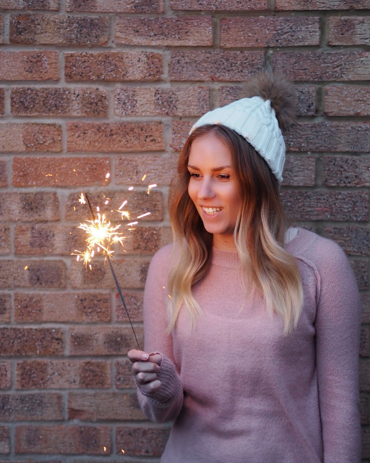 Lifestyle | Making 2018 My Best Year Yet Rachel Emily in a Bobble hat with Sparkler Smiling