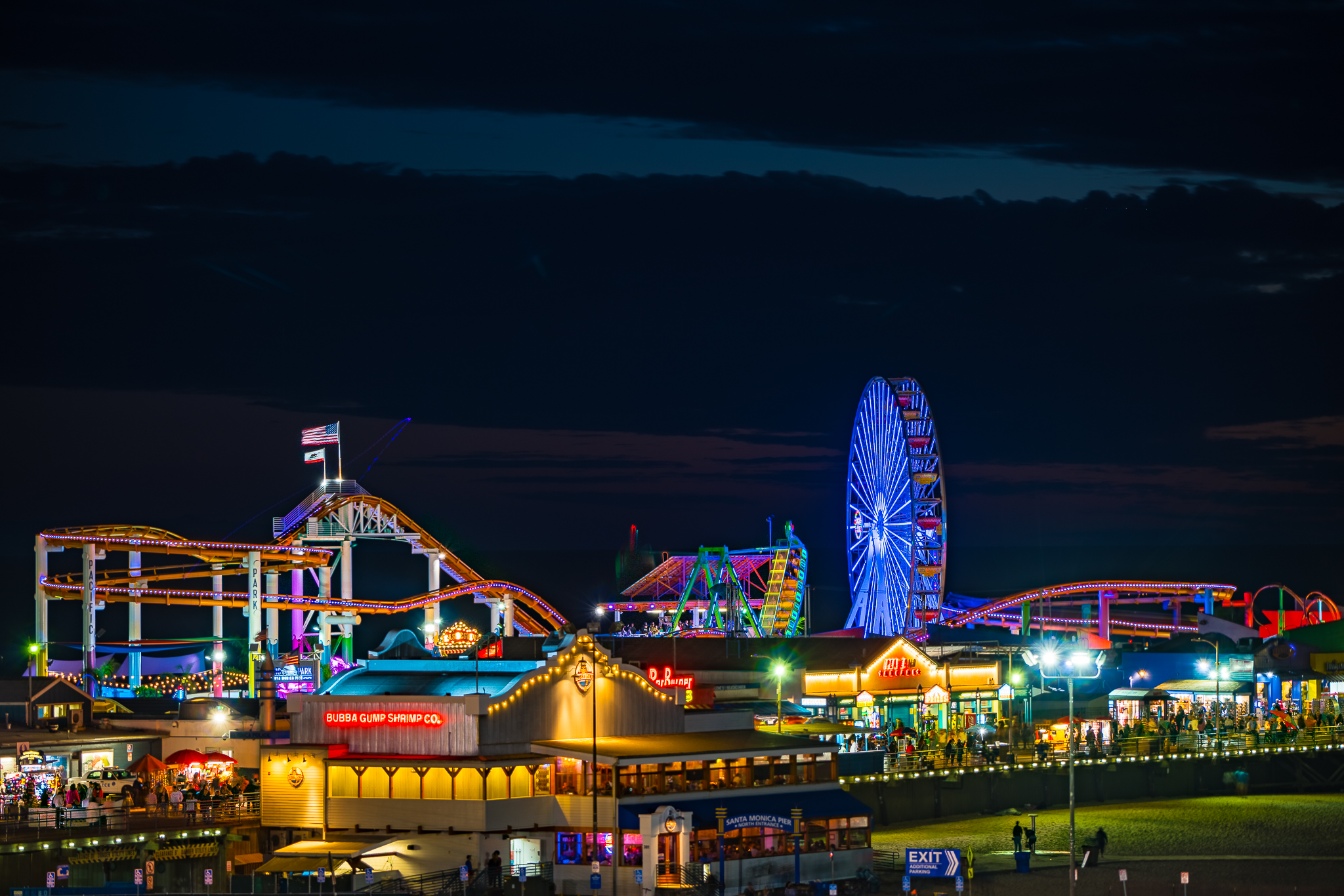 a photo of the santa monica pier at night los angeles california