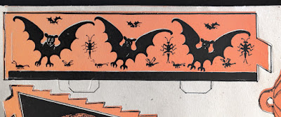 An example of a vintage die cut by Beistle with bats and bugs. Intact.