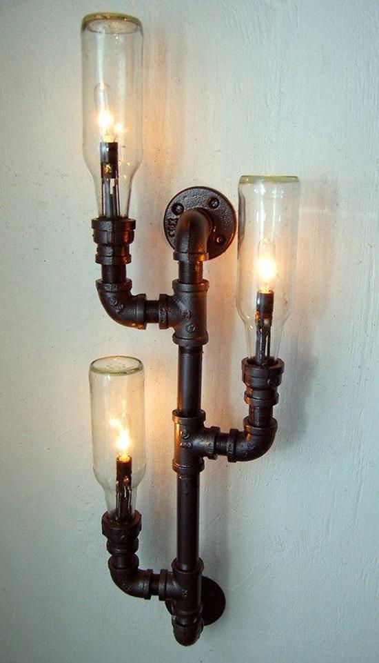 Desain lampu dinding menggunakan pipa besi bekas
