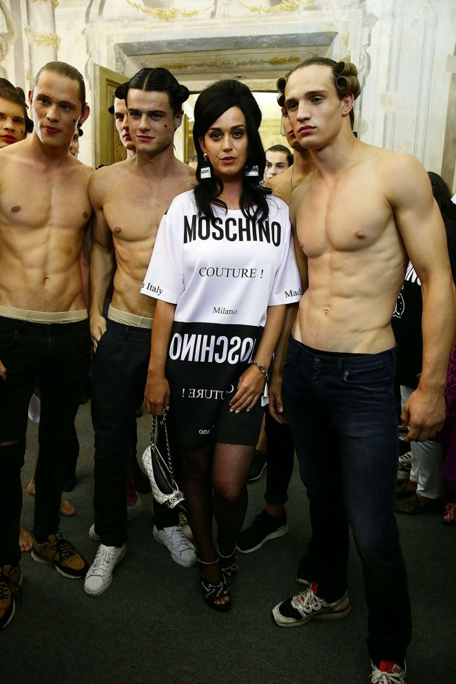 Katy Perry with shirtless models at the Moschino Fashion Show in Florence