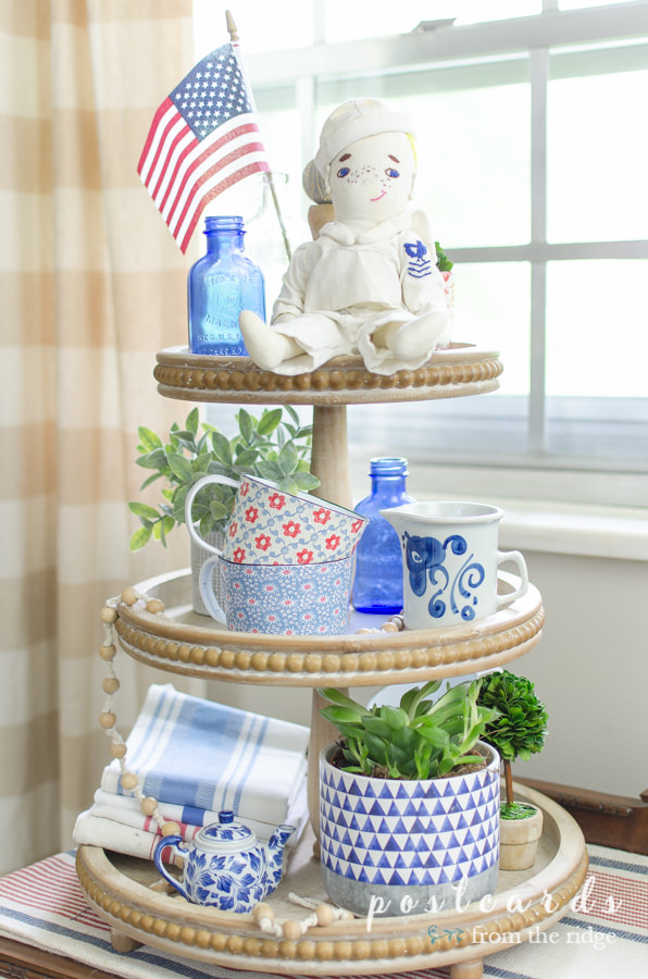 patriotic red white and blue decor on a three tier wooden tray