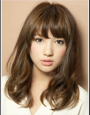 model rambut pendek sesuai bentuk wajah lonjong