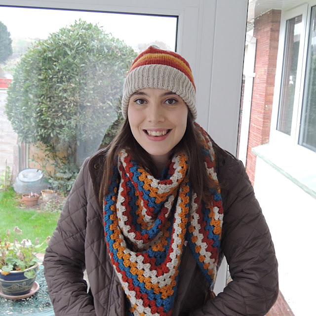 Woman wearing stripy knitting hat and crocheted scarf