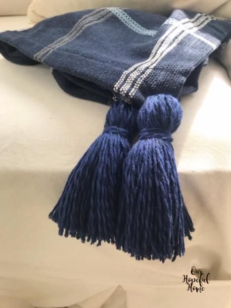 two navy blue yarn tassels