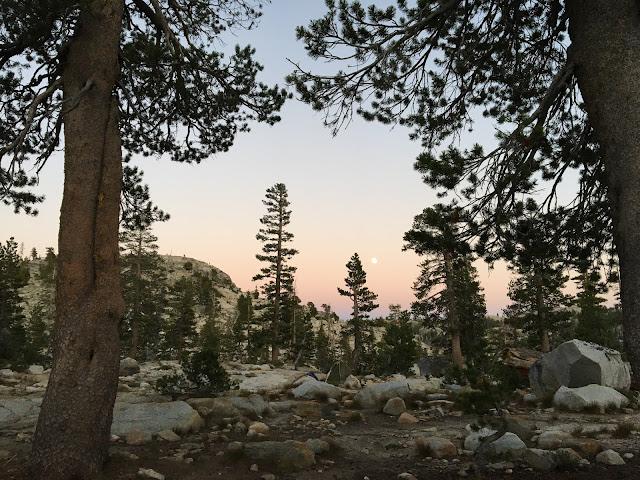 moon rises over Sierra Nevada landscape